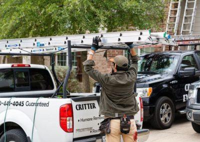 Animal Control Technician Getting Ladder